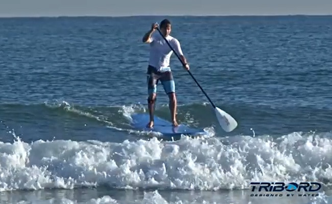 Prendre sa première vague backside en stand up paddle avec Tribord